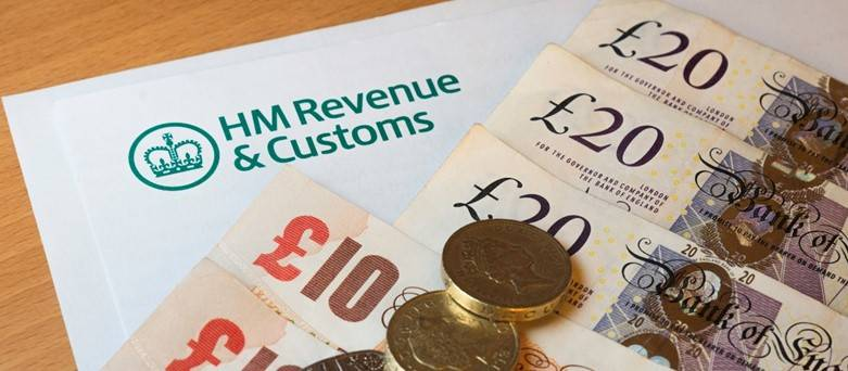 Claiming Tax Relief, HMRC logo within £10 and £20 notes laying on top