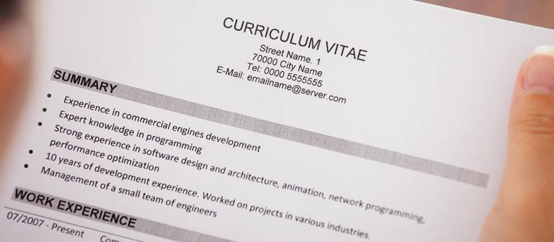 CV templates blog, person holding a CV in their hands