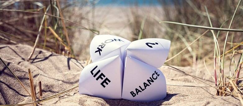 8 steps to achieving work/life balance - National Work Life Week ,  paper with the words , Life and Balance printed, on a background of a sandy  beach