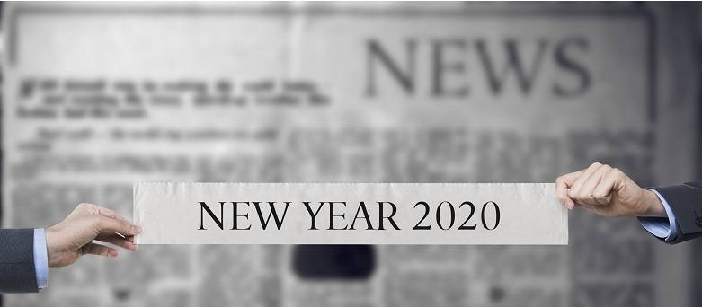 Caree blog - male holding up New Year 2020 banner