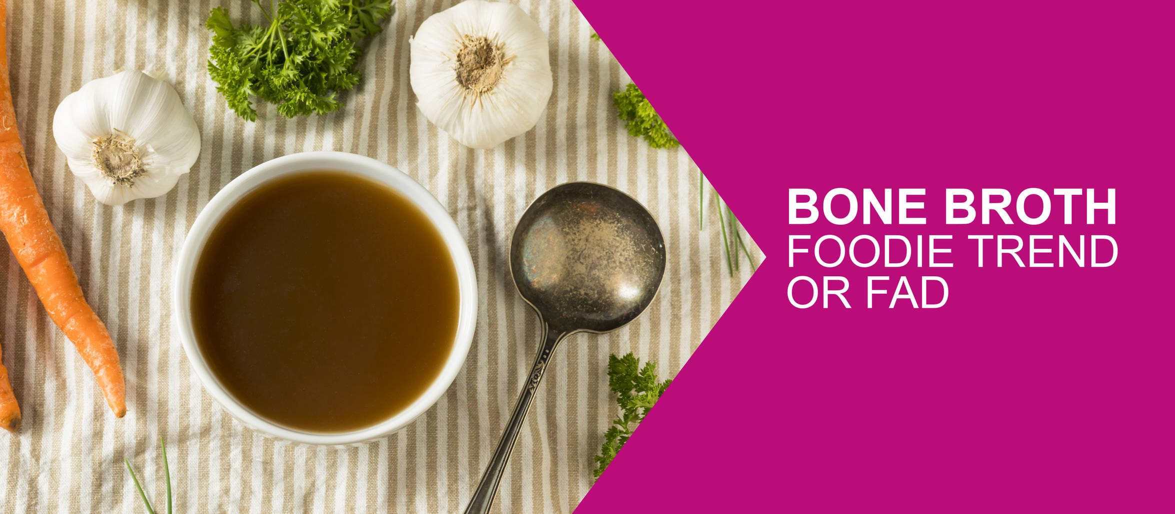 "Bowl of broth surrounding by garlic and carrots, overlayed with the title "" Bone broth foodie trend or fad"