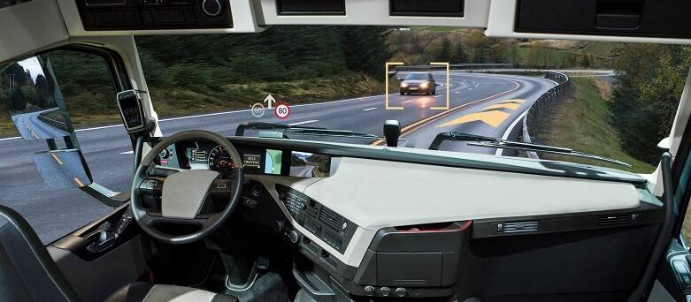 Image of a Truck with a view of a sensor picking up a vehicle on the road ahead.