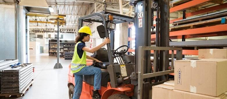 Interview - Forklift Driver, female worker stepping onto the forklift