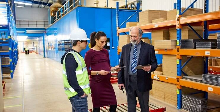 Pregnancy in a warehouse environment, pregnant female talking to Warehouse Manager and Warehouse Operative