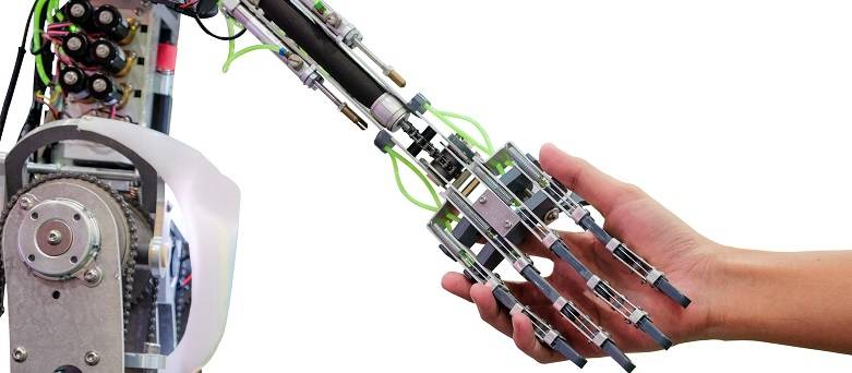 Hand holding a robotic arm
