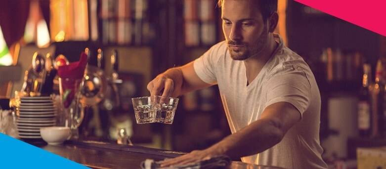 How to become a bartender , Male Bartender cleaning the bar