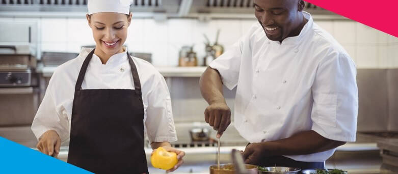 Male and Female Chef chopping vegetables and stirring a pot. How to become a Chef de Partie  - Blue Arrow Career Guides