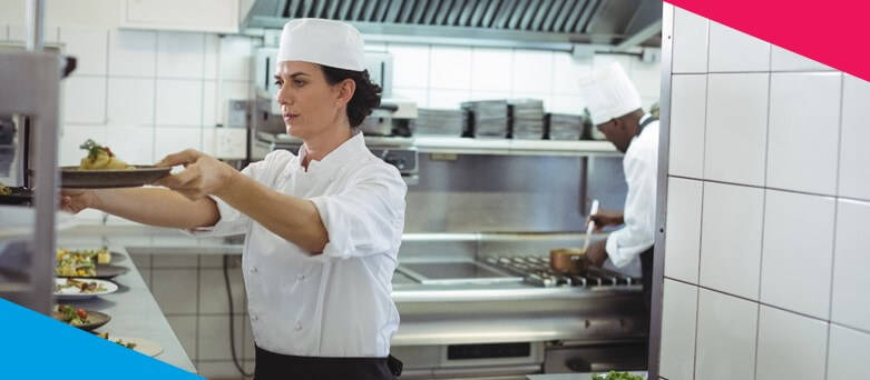 Female Chef putting plates up on the counter to be served. How to Become a Commis Chef - Blue Arrow Career Guides