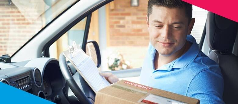 How to become a delivery driver? Delivery Driver with blue top sitting in Van checking the address on a package
