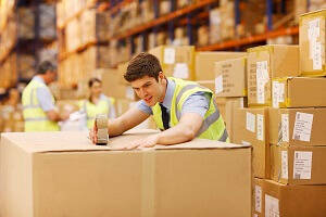 Apprenticeships by Blue Arrow  - Warehouse Operative Level 2 - A warehouse operative closing a box