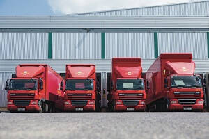 4 Royal Mail HGV Trucks at distribution centre.