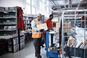 Two Male Mail Sorters in Royal Mail Sorting office