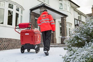 Royal Mail Postman delivering mail in the snow.