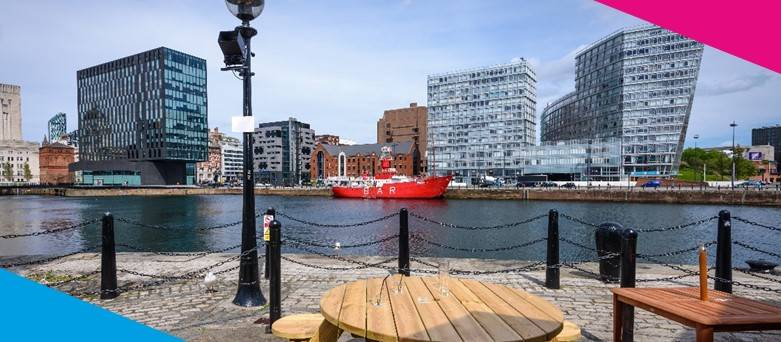Chef Jobs Liverpool,  Wooden seating at Liverpool waterfront with a view of famous red boat at canning dock Liverpool, UK.