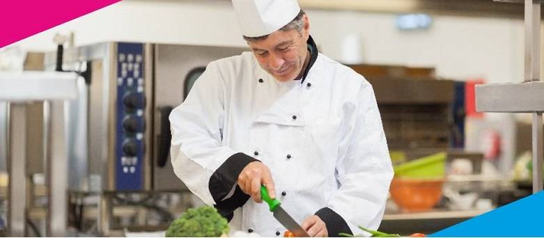 Chef Jobs Peterborough, male Head Chef chopping vegetables