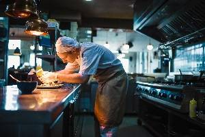 Best town to work in - chef preparing meal in kitchen