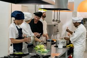 Group of chefs preparing vegetables in the kitchen