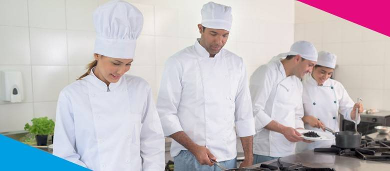 Different types of chefs preparing food in the kitchen