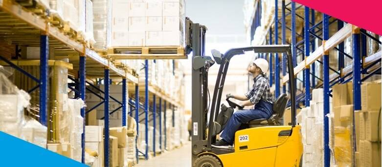 Being a Forklift Truck Driver  - A male FLT Driver, putting a pallet of boxes onto a high shelf