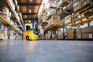 Forklift Truck Driver Job Description  - Make FLT Driver moving a pallet of boxes