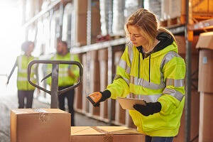 Wahouse Essential Skills  - Femal Warehouse Operative scanning a box on a pallet