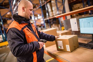 Warehouse Operative Job Description - Male Warehouse Operative Scanning a box