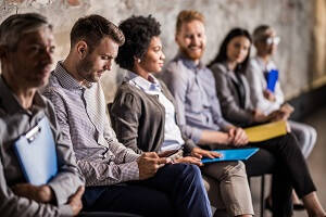 Employment news - what does the new Plan for Jobs scheme mean for you? blog image, people in a waiting room for an assessment.