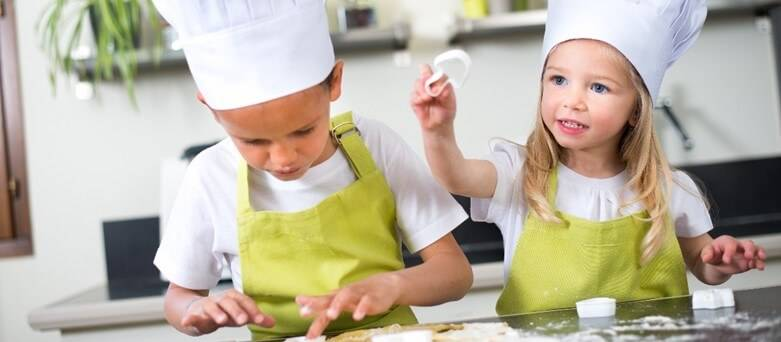 Gender Pay Gap  - Boy and Girl cutting dough shapes in the kitchen